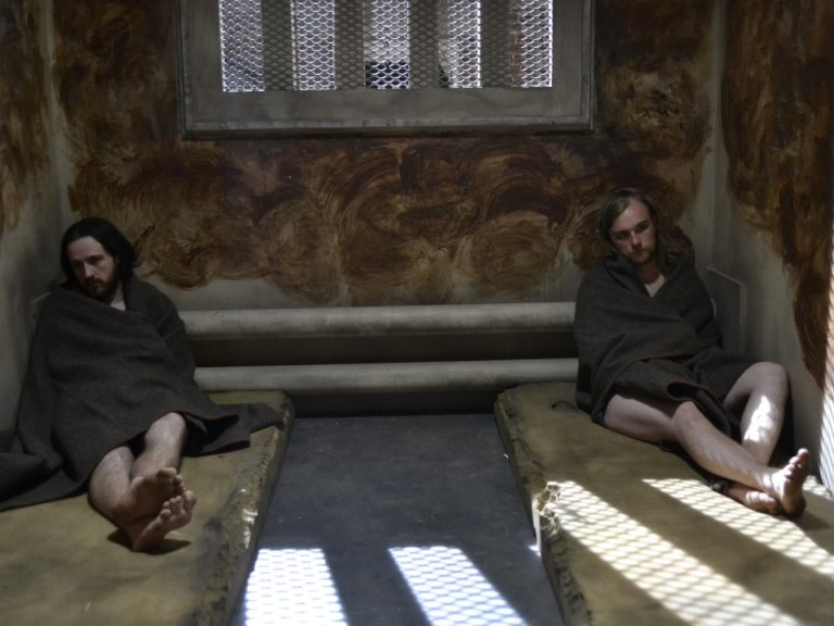 Still from 66 Days, showing two men in a prison cell, following a 'dirty protest' (detail of original image only)
