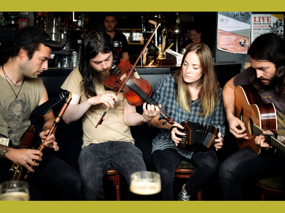 Band image with all four members playing instruments (c) Brian Flanagan