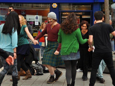 Movema leading a street ceili