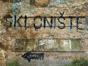 Photograph of 'Skloniste' graffitied on a wall (c) Jim Marshall
