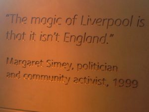 """Image of Margaret Simey's quote """"the magic of Liverpool is that it isn't England"""", seen here as inscribed on a pillar at the Museum of Liverpool"""