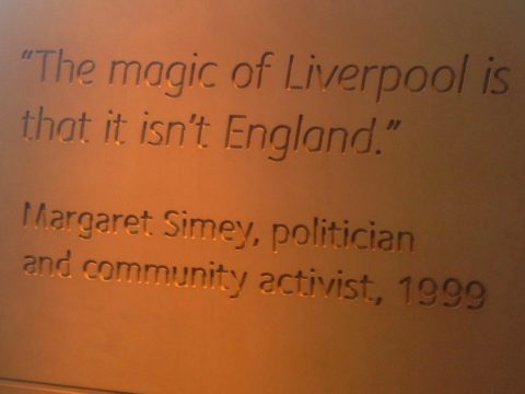 "Image of Margaret Simey's quote ""the magic of Liverpool is that it isn't England"", seen here as inscribed on a pillar at the Museum of Liverpool"