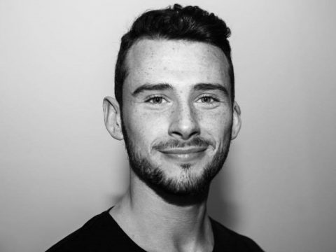 Cameron McKendrick's Misterman headshot (black and white, close face portrait)
