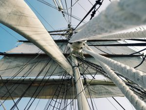 A view up through a tall ship's rigging