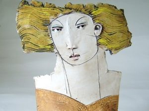 Close up detail of a ceramic statute of a women by Christy Keeney