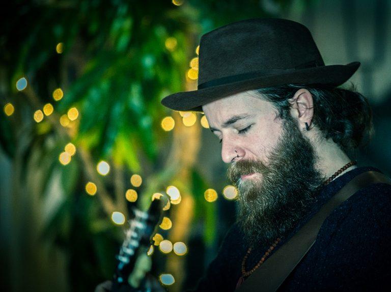 Dave O'Grady of Seafoam Green plays guitar