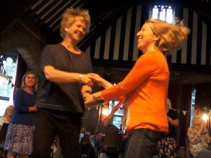 Two women dancing in a ceili