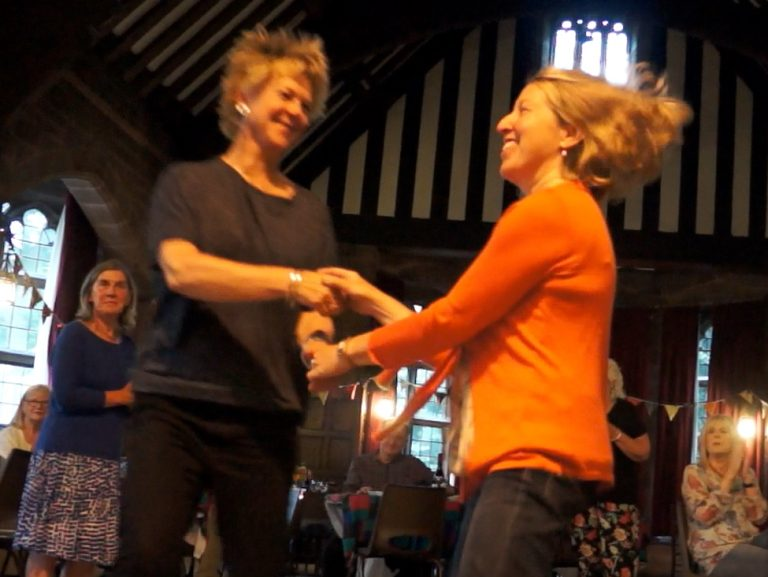 Two women dancing in a ceili