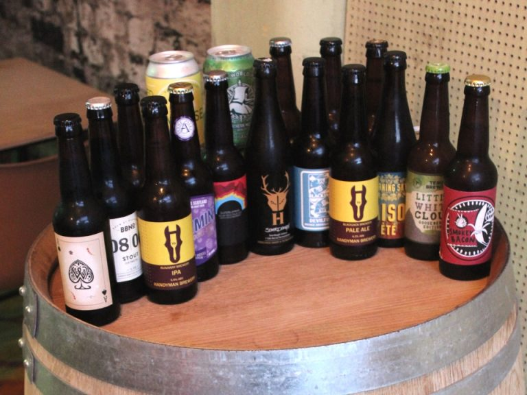 A selection of Liverpool and Irish craft beers on a wooden barrel top (detail) (c) Pedro Cozier