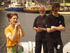Sue Rynhart singing on board La Malouine with Skipper Roy Kerr and technician from Adlib