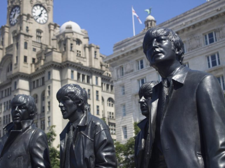 Pier Head image of The Beatles stautes in front of the Cunard and Liver Buildings (c) E Smith